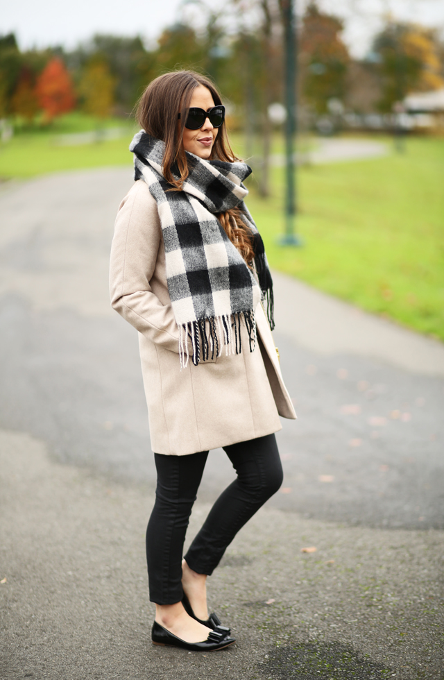 tan coat black and white scarf