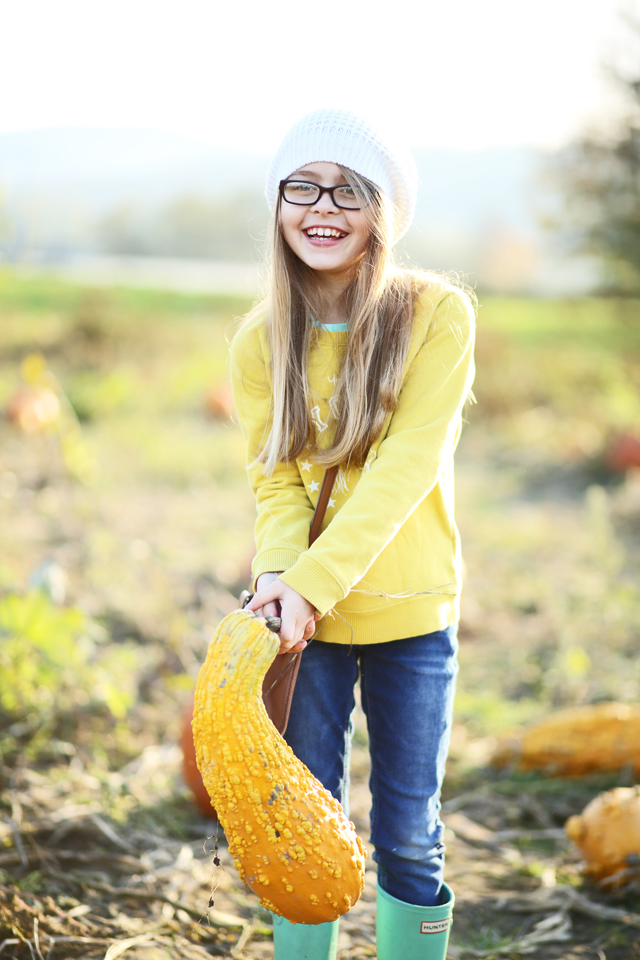cute girl and a giant gourd