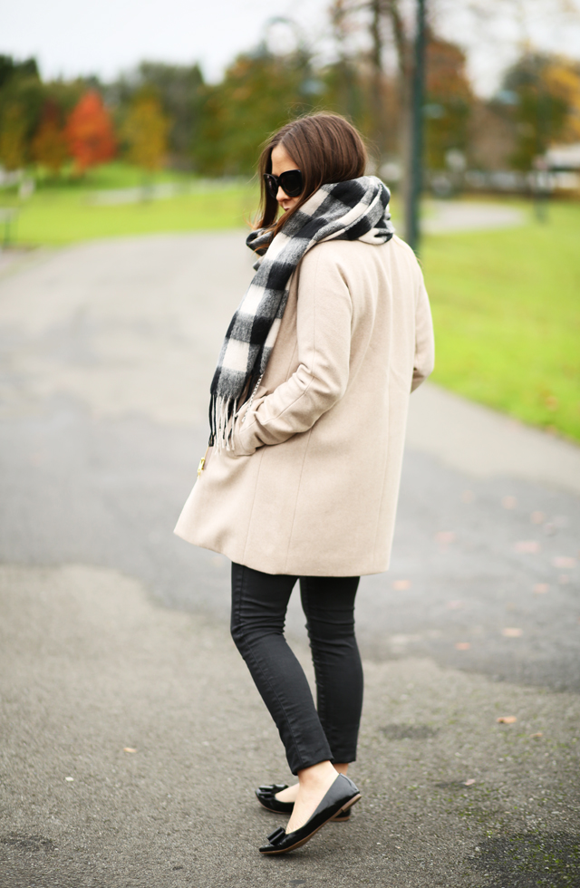 black skinny jeans tan coat buffalo scarf