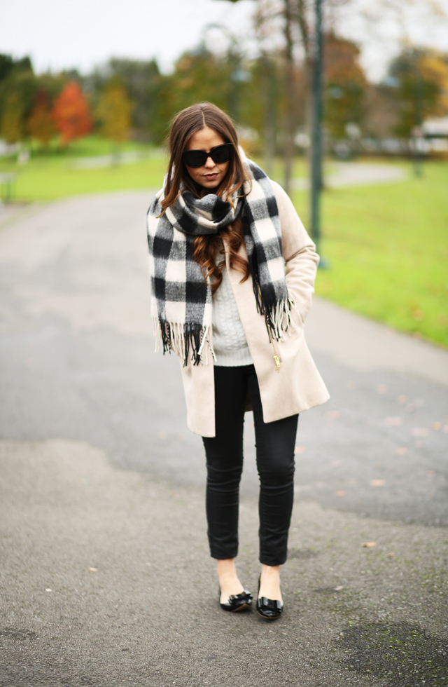 tan coat with black and white buffalo check scarf