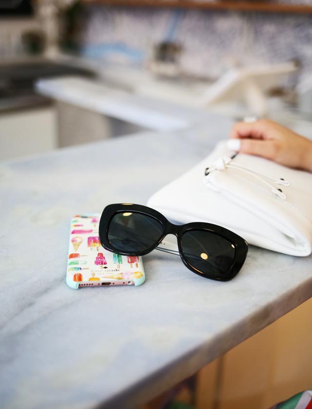 sunglasses clutch and a ice cream phone case