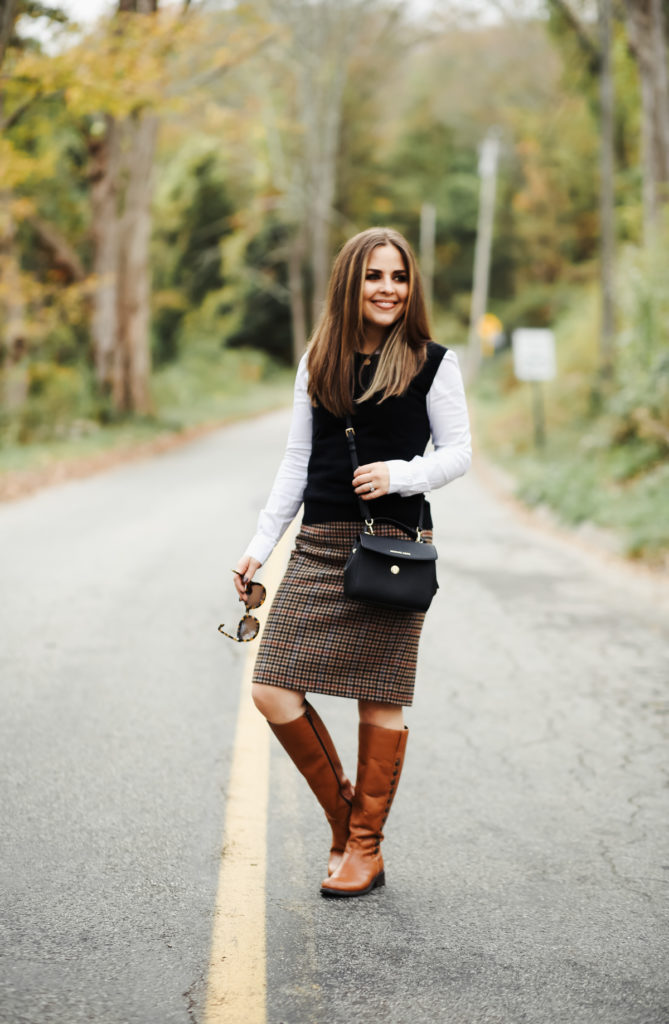 483aba1f4 J.Crew Factory Houndstooth skirt. J.Crew Factory Sweater Ves. White button  up. Similar Riding boots. Michael Kors Bag. Sunglasses.
