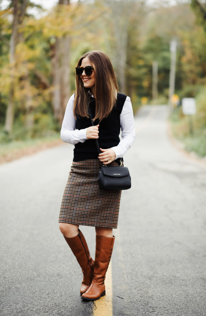 9b351757f ... preppy fall outfit. J.Crew Factory Houndstooth skirt. J.Crew Factory  Sweater Ves. White button up. Similar Riding boots. Michael Kors Bag.  Sunglasses.